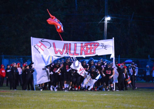 Pleasant takes the field before the start of its football game with River Valley last season.