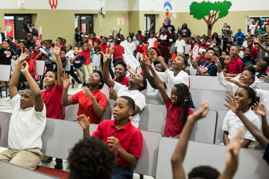 October 22 2018 - A. B. Hill Elementary School students reach up for T-shirts during the We Are 901 Celebration Tour stop Monday afternoon.