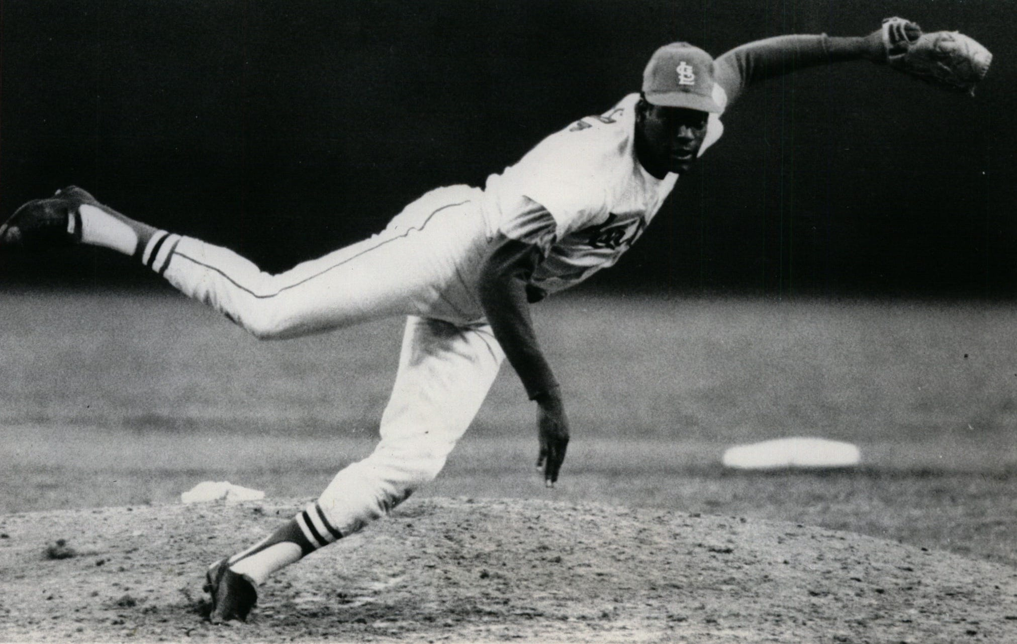 St. Louis Cardinals ace Bob Gibson hurls another pitch during Game 1 of the 1968 World Series against the Detroit Tigers. Gibson struck out 17 batters in the game, which is still a World Series record.
