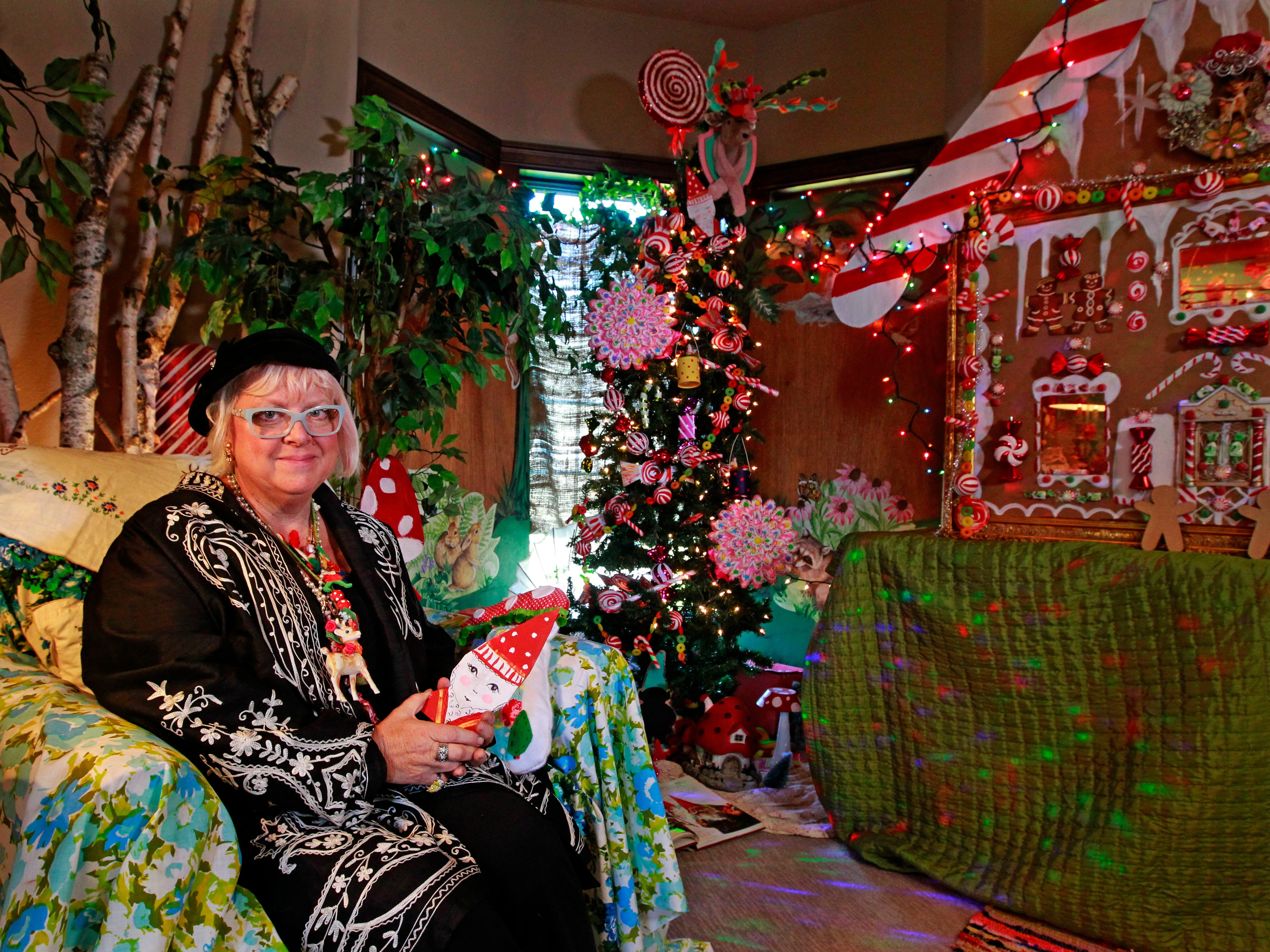 "Designer, Vanessa ""Kiki"" Johanning is photographed in the room she decorated, ""Enchanted Gingerbread Forest."""