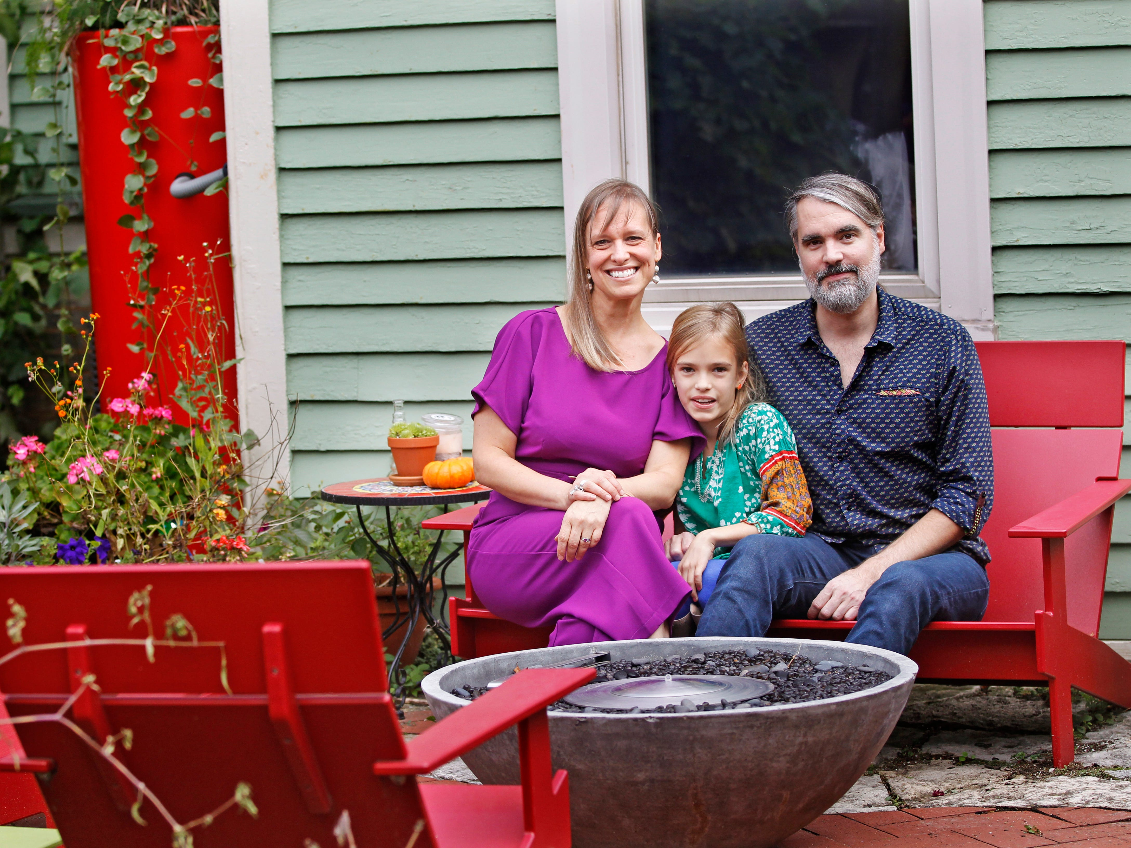 Mara Duckens, Elena, 9, and Kevin Kriehn relax on the patio of their Milwaukee home.