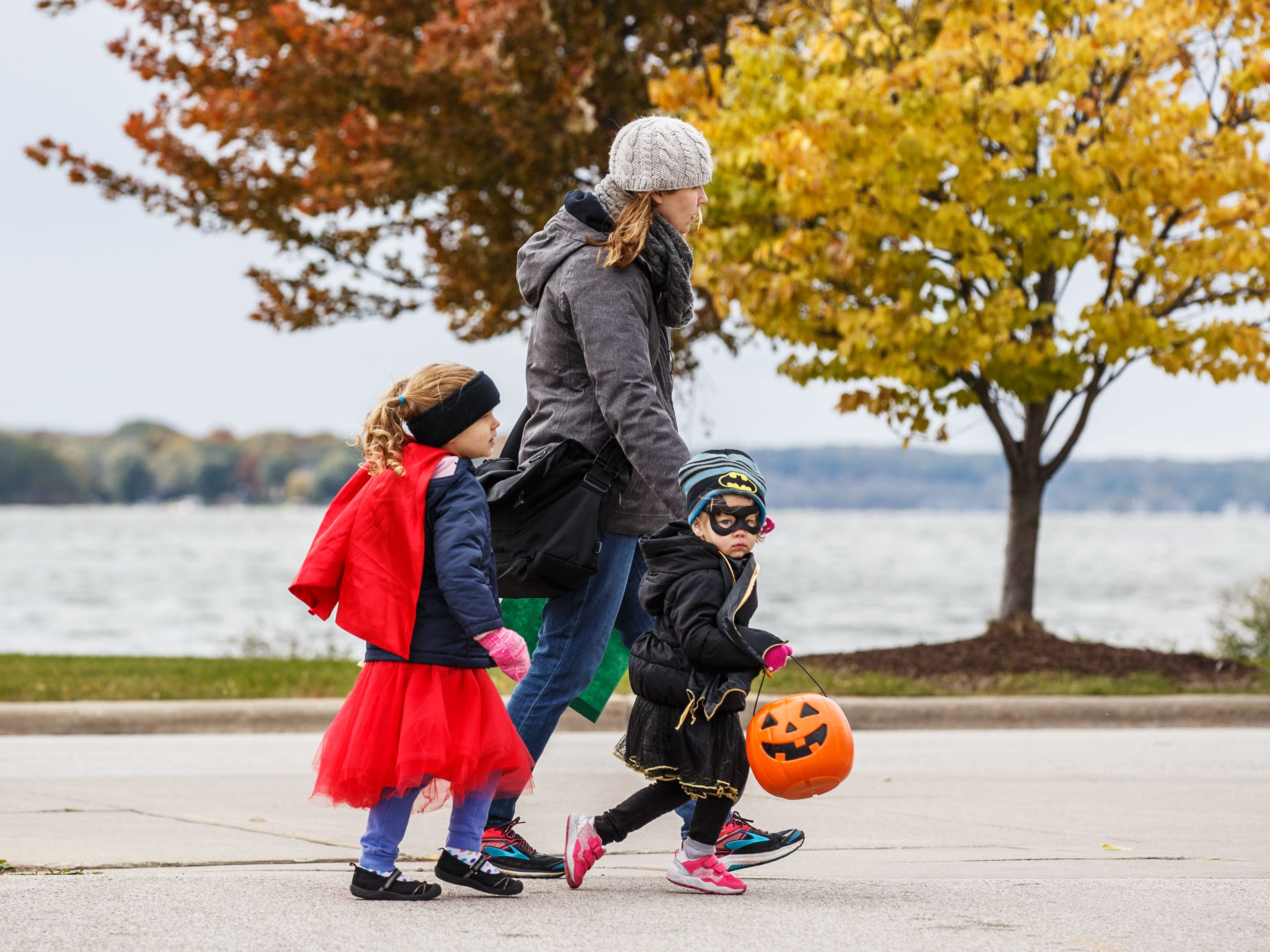 Trick-or-treaters are not deterred by a little snow, wind or chilly temperatures as they participate in the annual Halloween Fun Fest at Pewaukee's lakefront on Saturday, Oct. 20, 2018. The event, hosted by Positively Pewaukee, features a dog costume contest, trick-or-treating, games, crafts and fun from local nonprofits, churches and businesses.