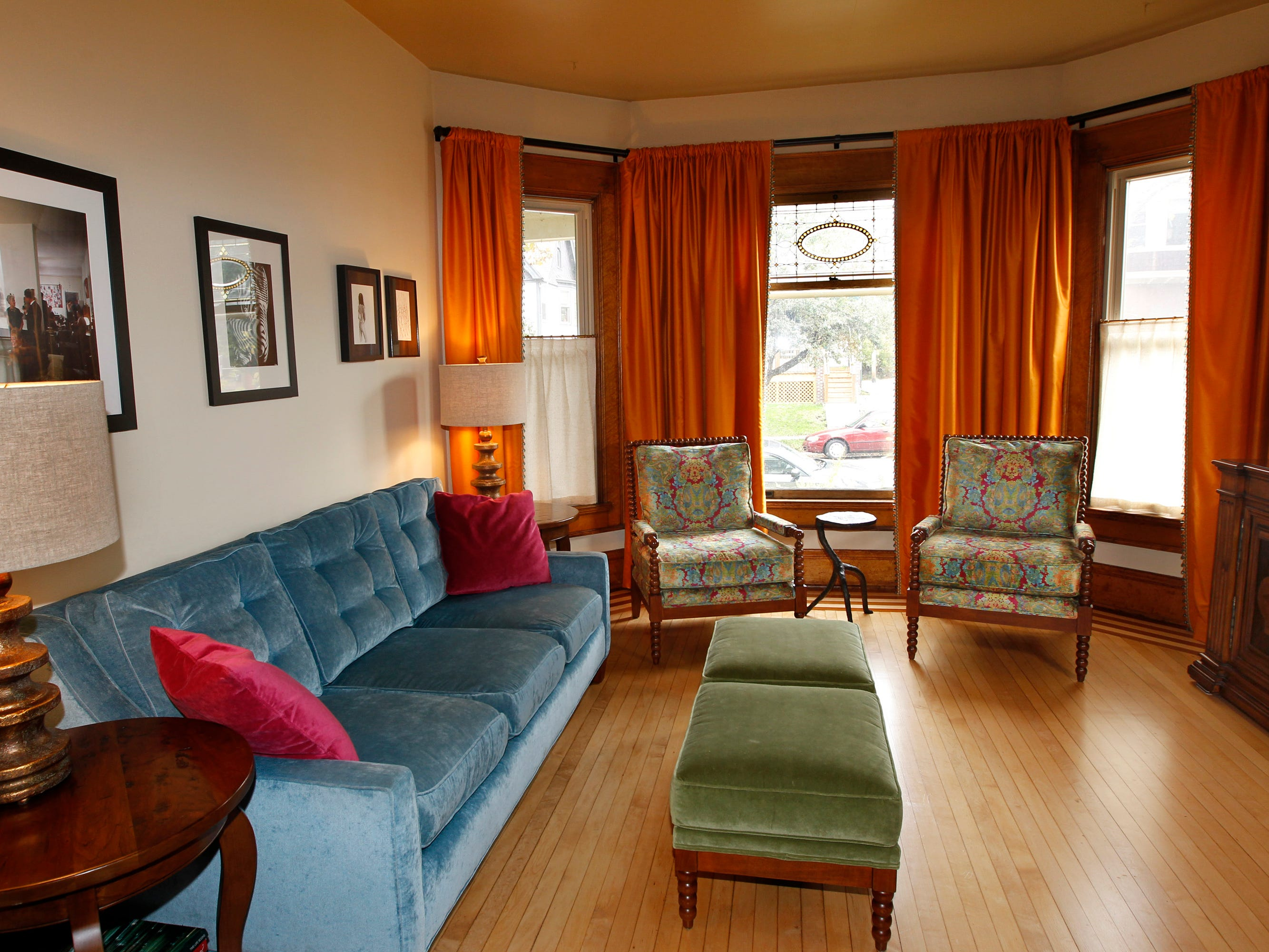 Mara Duckens and Kevin Kriehn had the two chairs near the window custom-built. The colors in the fabric are also seen in the sofa, ottomans and curtains.