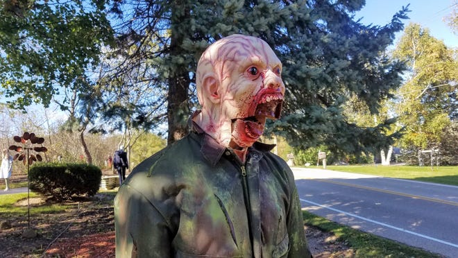 Geno Fleming puts intricate details on each zombie that fills his yard. This one is complete with a mouth that moves when turned on.
