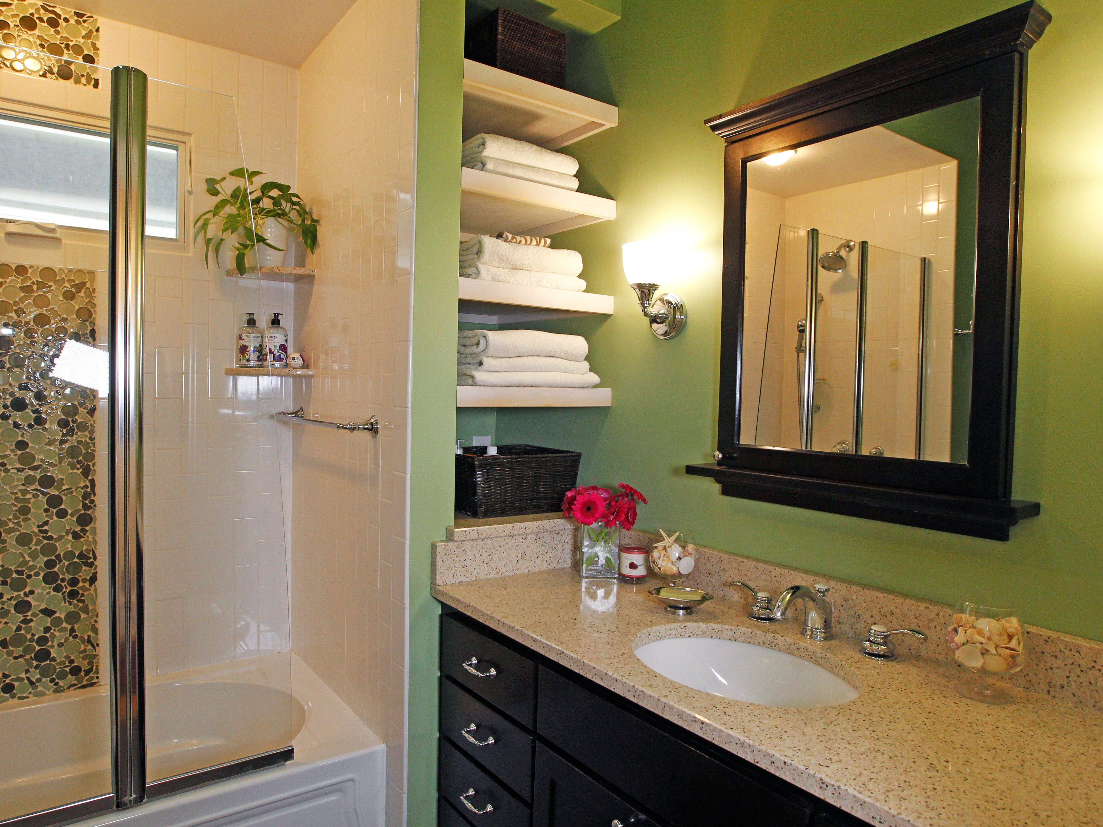 The bathroom was remodeled in 2010. The countertop is made from a mixture of recycled materials.