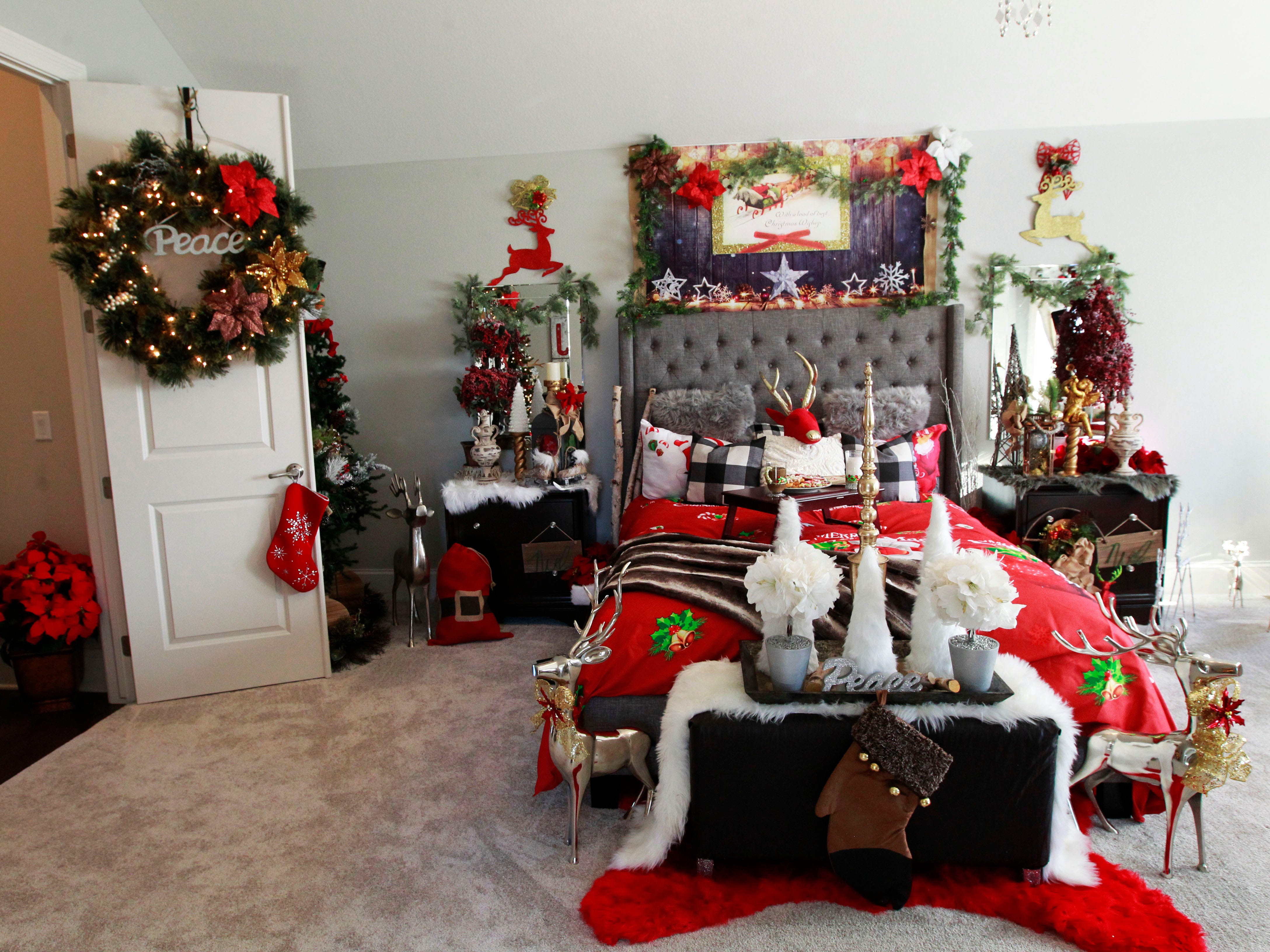 """The bed aptly fits the theme of this bedroom, decorated by Kendra Walker, entitled """"Santa's Rustic Glam Reindeer Room."""""""