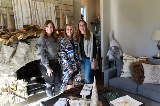 "Home designers (from left) Elizabeth Rennicke, Laura Goranson and Heather Weber decorated this room, entitled ""Elegant Christmas."""