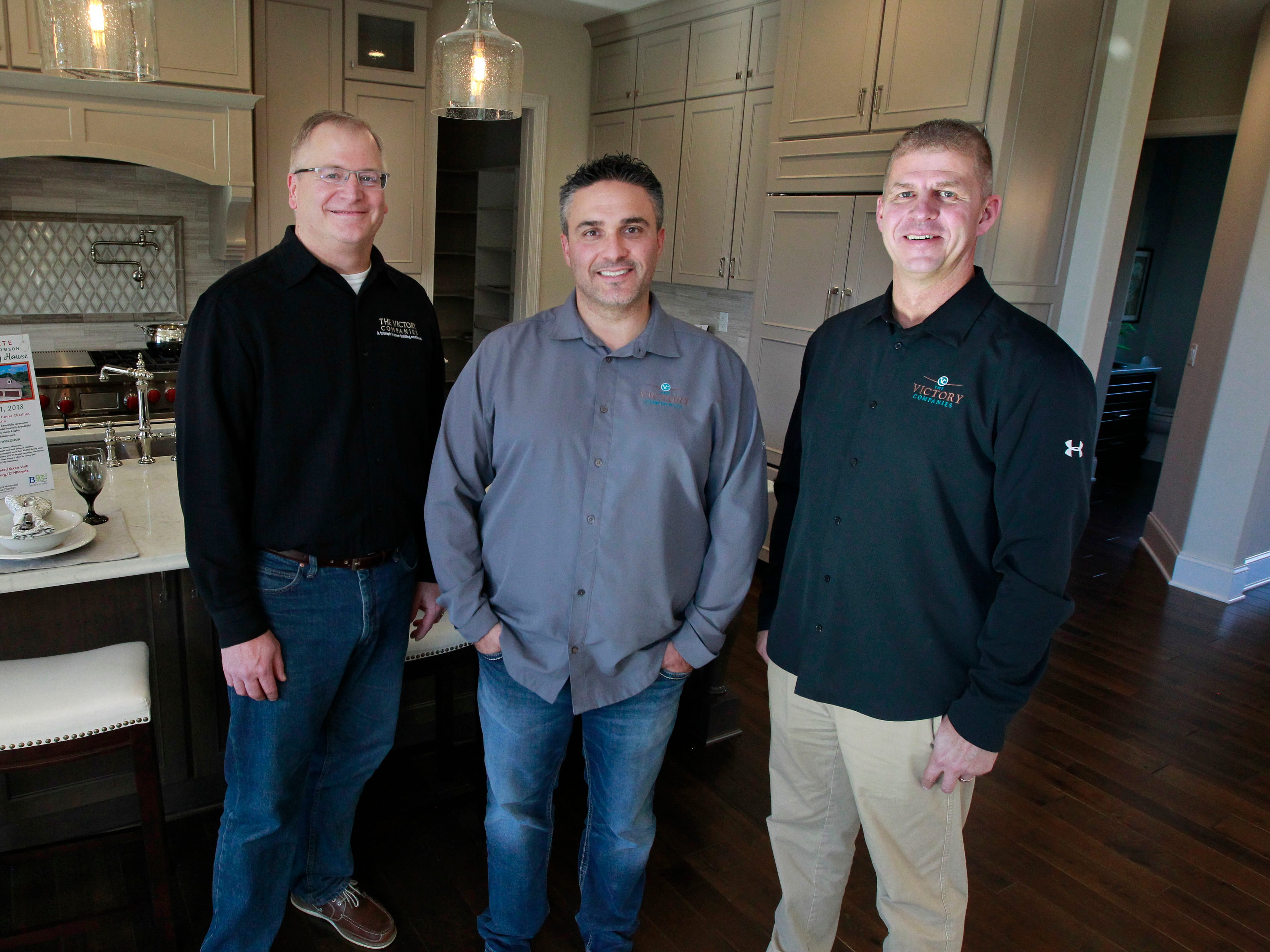 Owners of the Christmas Fantasy House from The Victory Companies are (from left) David Pluim, vice president; David Roembke, vice president of sales; and John Stoker, president.