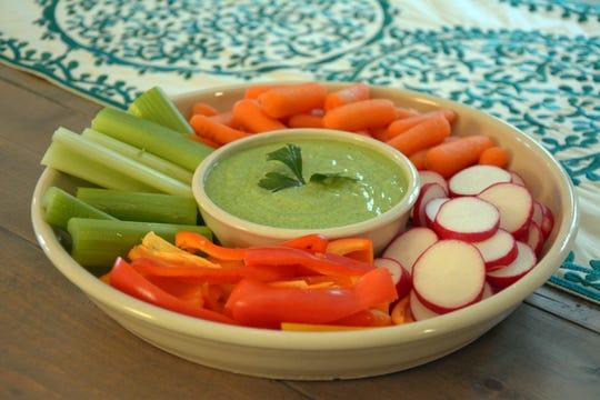 Crudites with a homemade green goddess dip is a crunchy start to dinner.