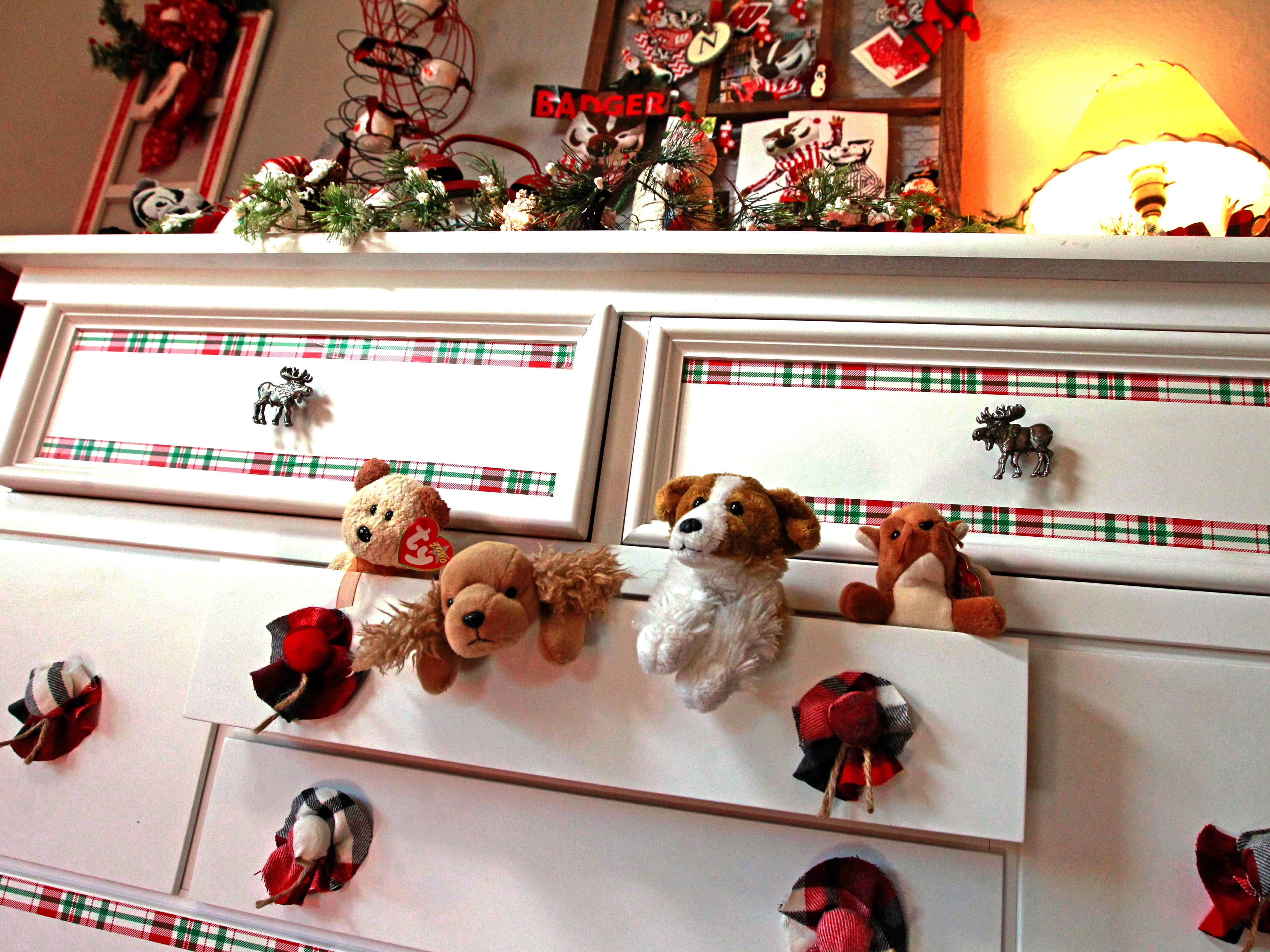 Stuffed animals spill out of a dresser drawer in this whimsical scene.