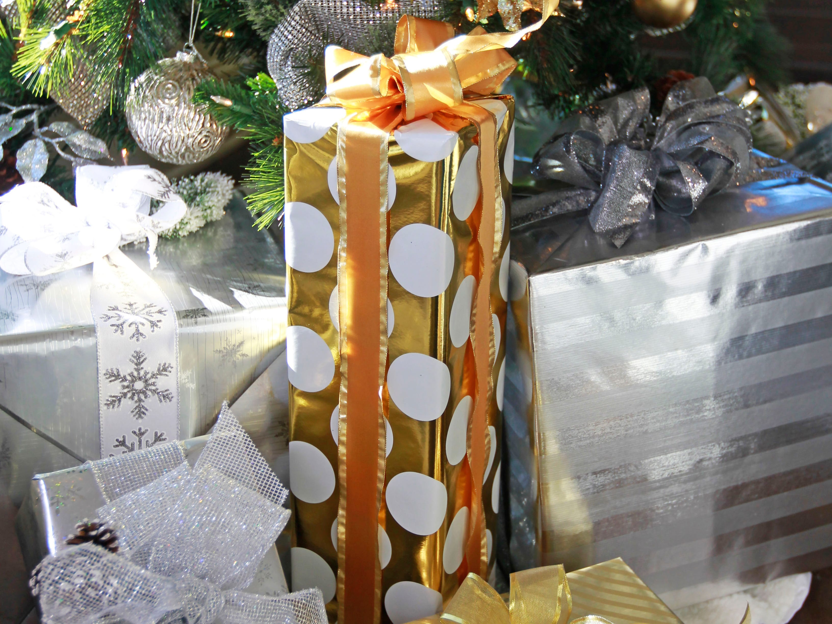 Even the wrapping paper for gifts under the tree are in coordinated silver and gold.