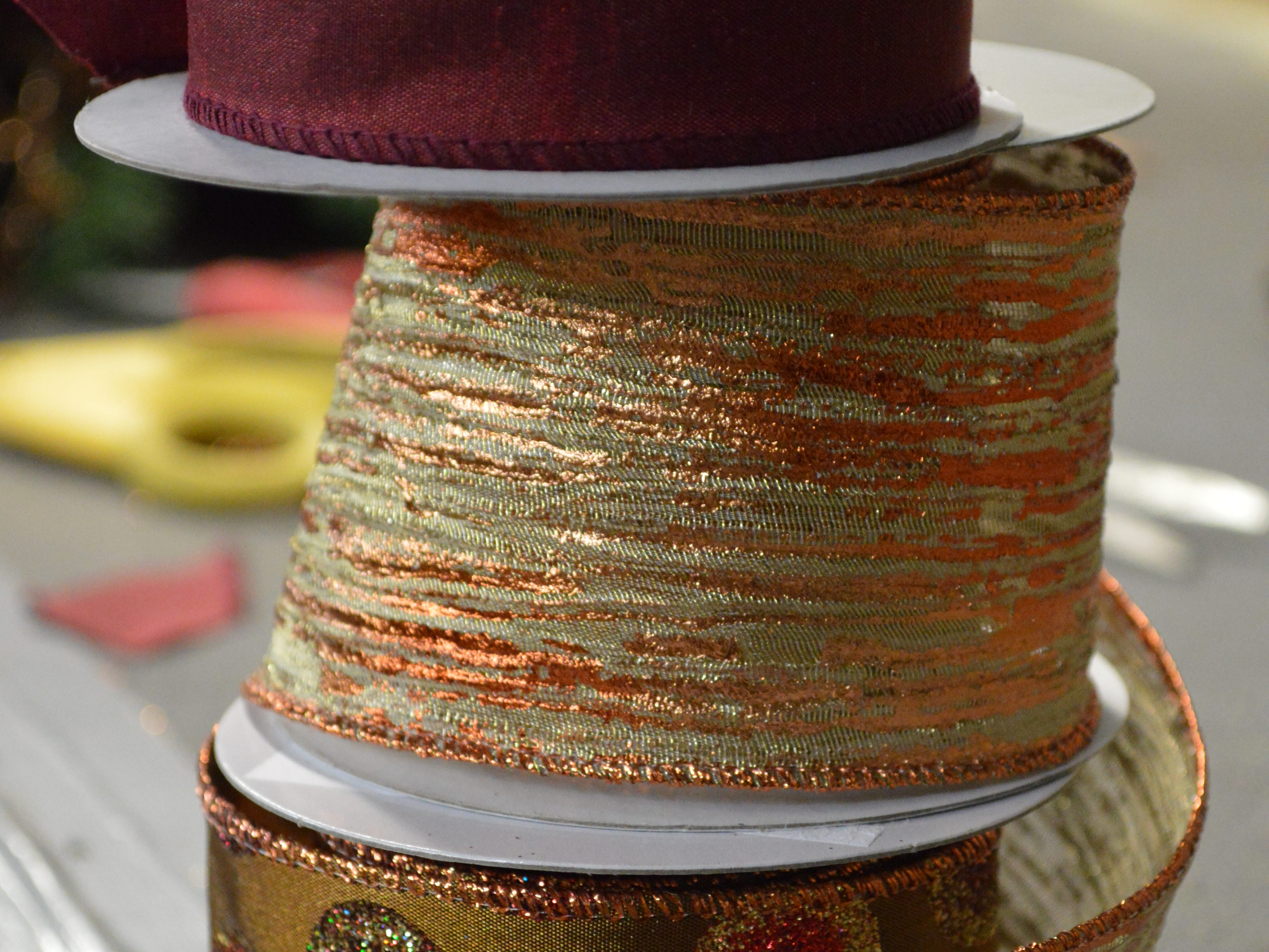 Grob said to use multiple types of ribbon for texture and layers of color.