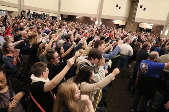 People at UWM cheer a call for a $15 an hour minimum wage.