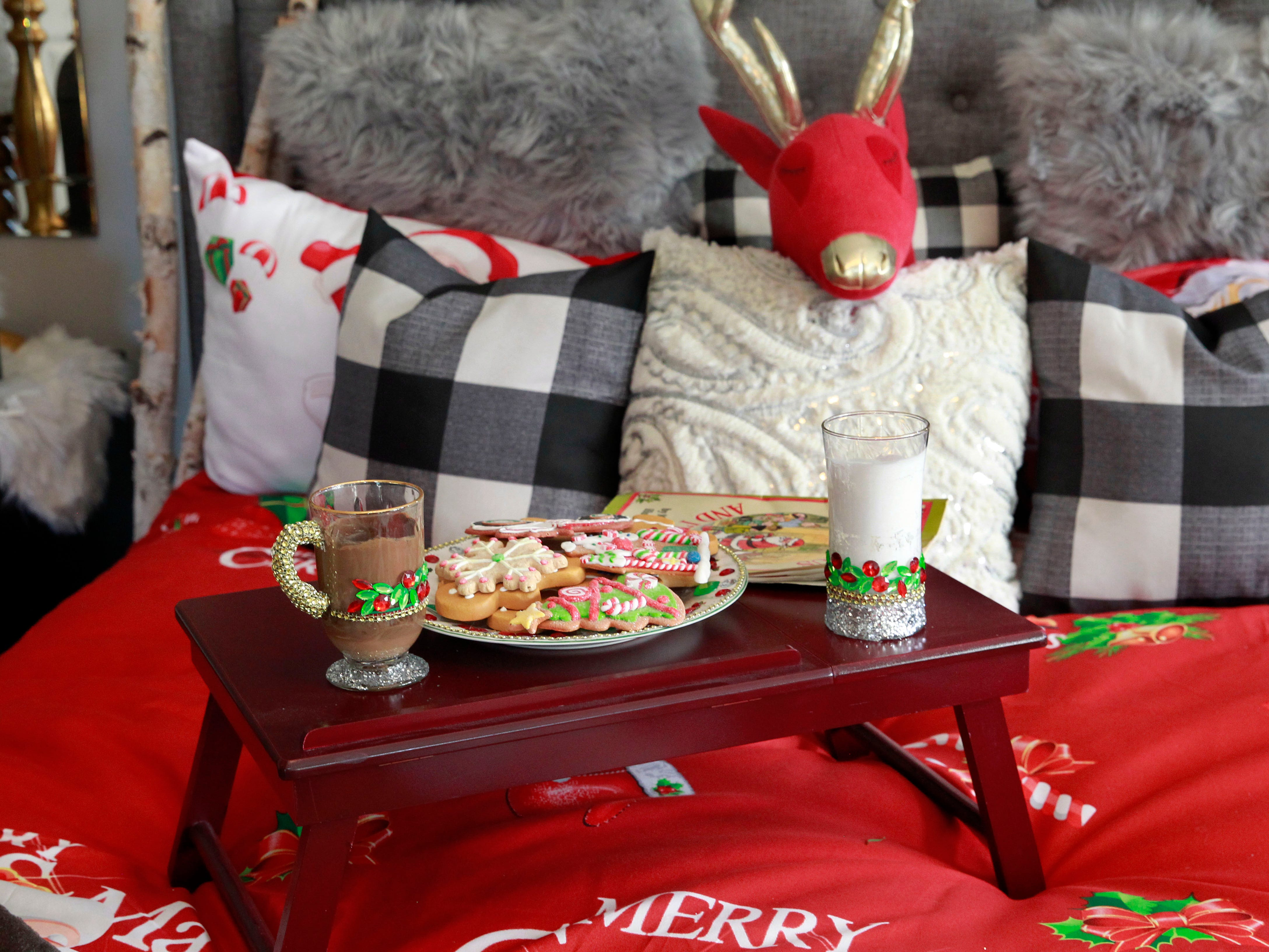 Cookies, cocoa and milk are left for Santa on the bed.