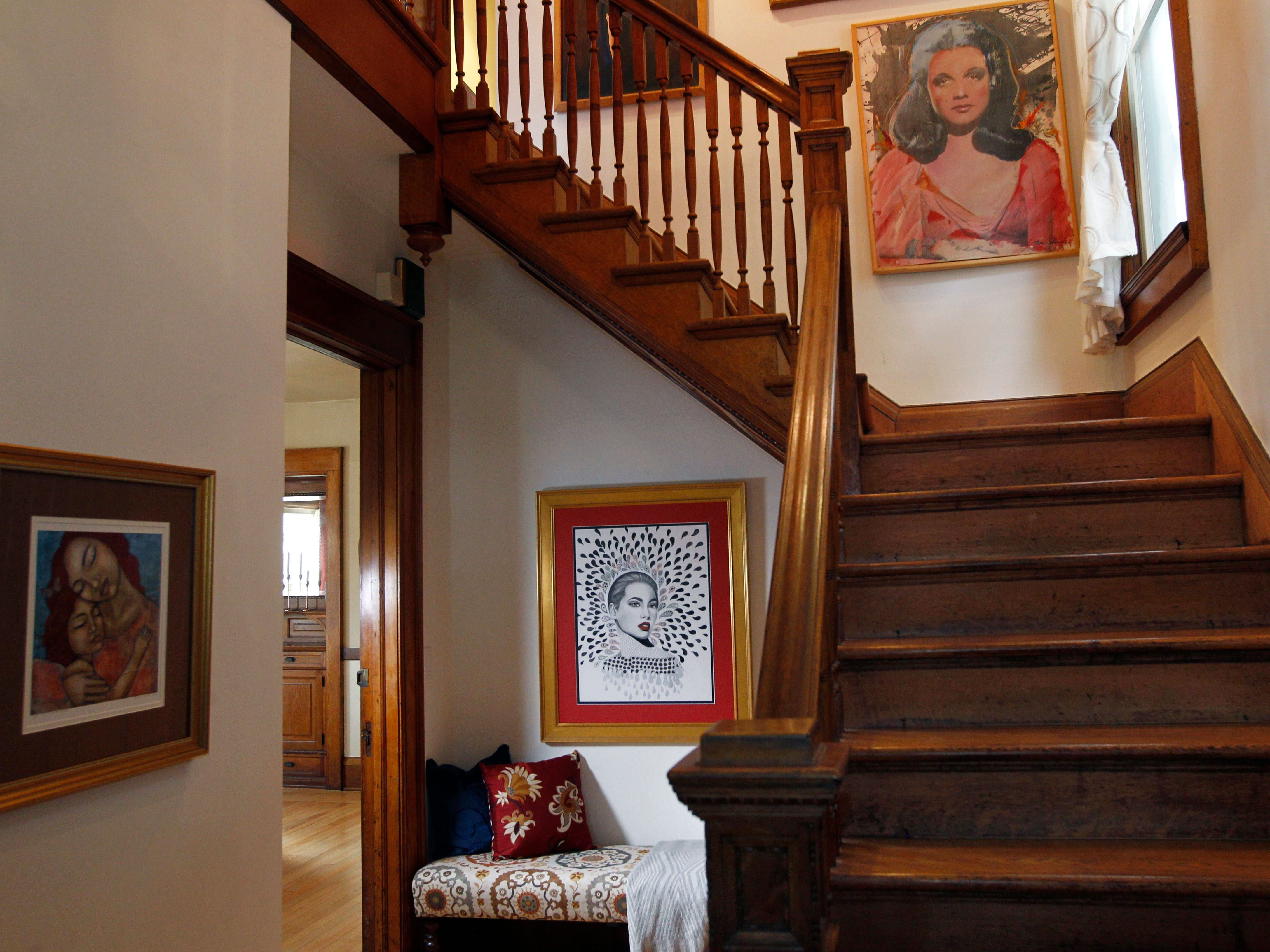 An original pen and ink art piece by homeowner Mara Duckens is displayed near the stairs. The home is filled with artworks from a variety of artists whose work the couple has collected over the years.