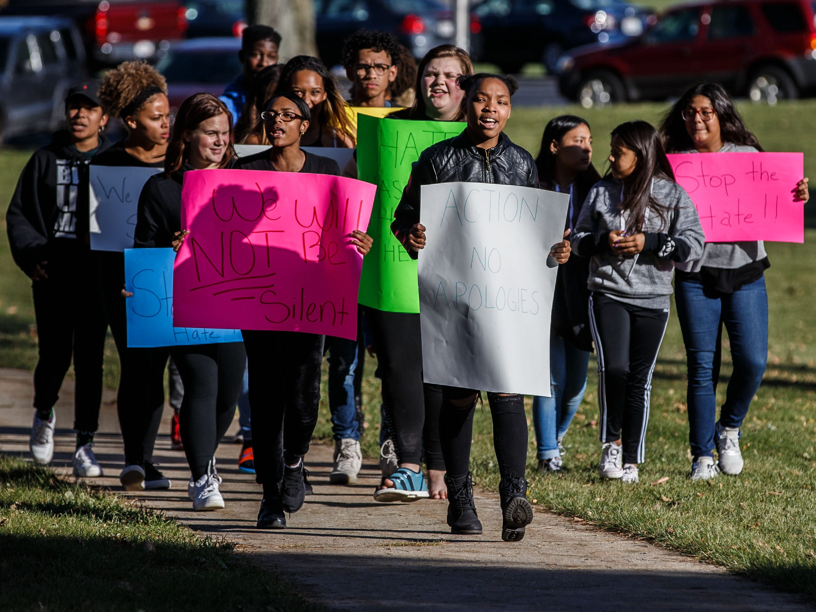 Chanese Knox (center) leads a student protest in front of Greendale High School on Monday, Oct. 22, 2018 in reaction to a racial-slur incident.