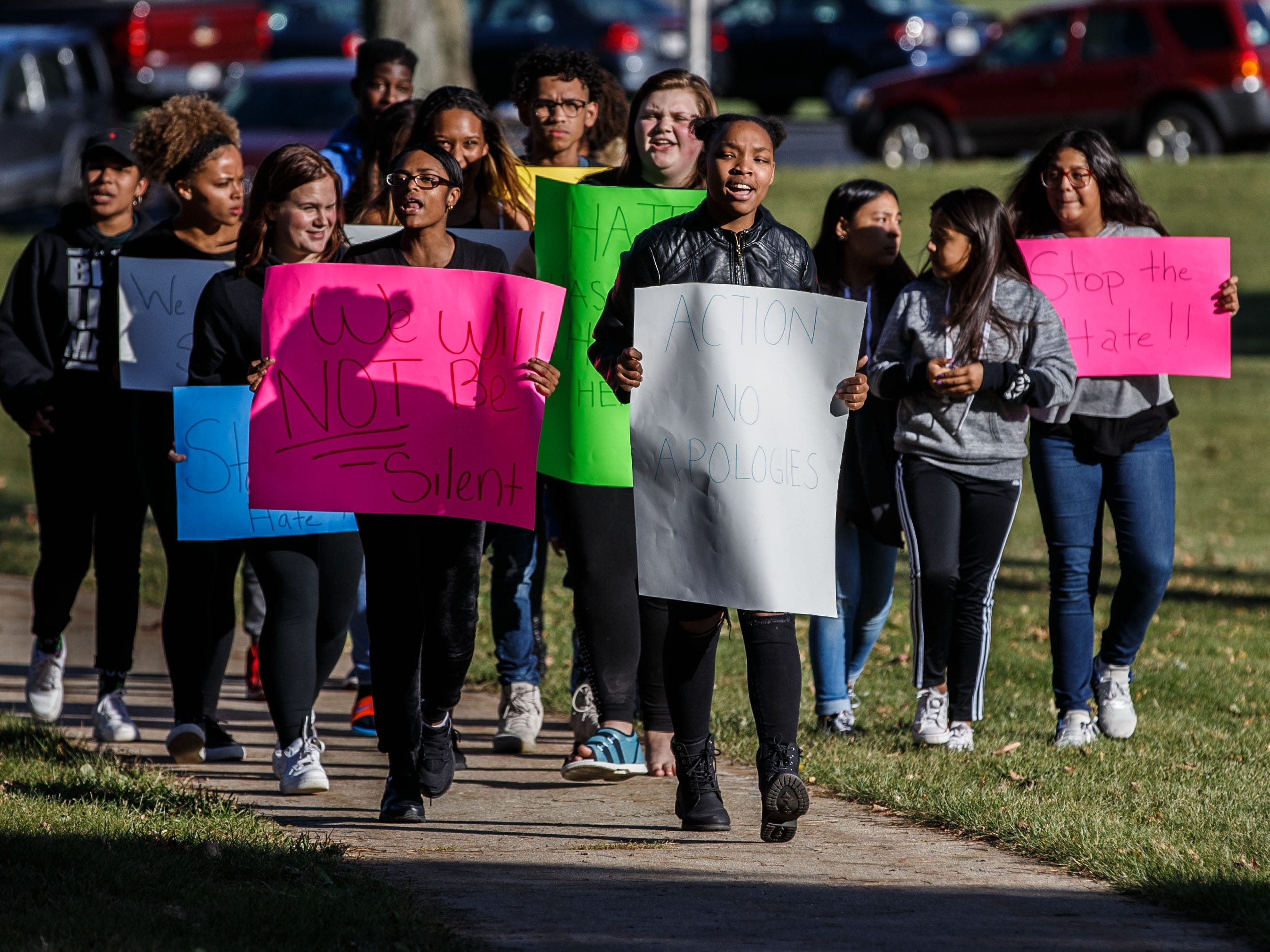 Chanese Knox (center) leads a student protest in front of Greendale High School on Monday, Oct. 22, 2018, in reaction to a racial-slur incident.
