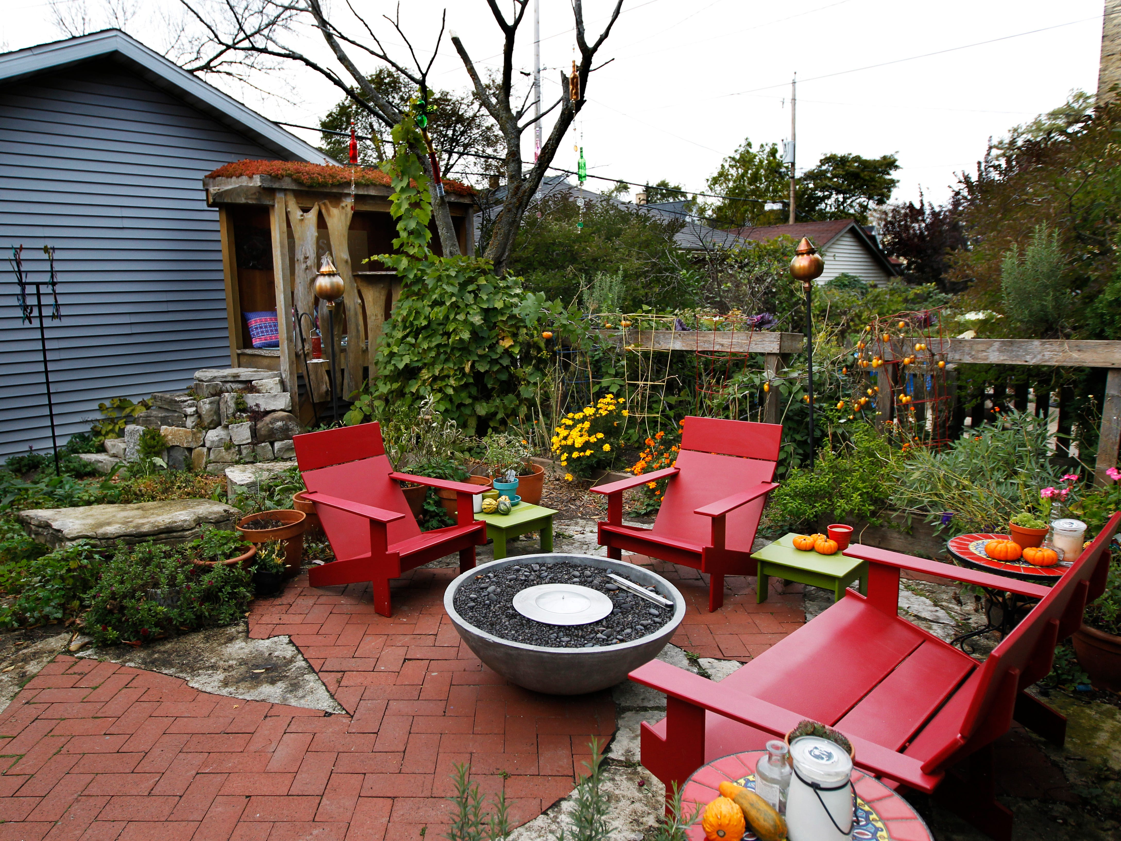 Colorful patio furniture adds a pop of color in the backyard garden.