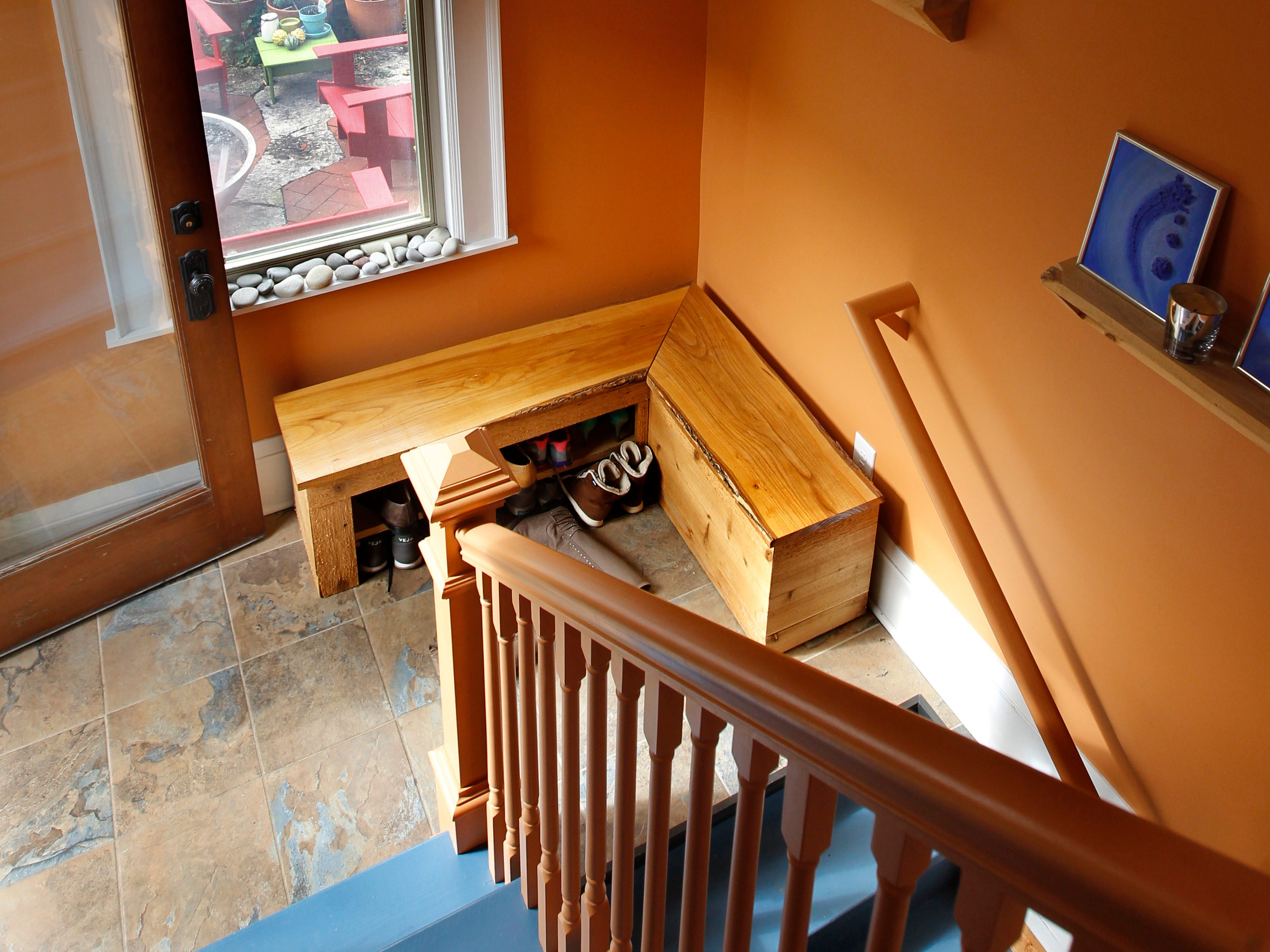 A colorful mud room sits at the bottom of the back stairway.