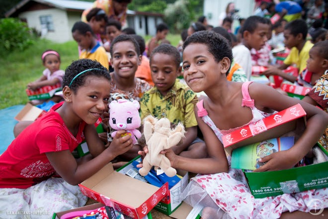 Children in Fiji receive gifts as part of the Operation Christmas campaign. Two locations will collect gifts for OCC in Baxter County