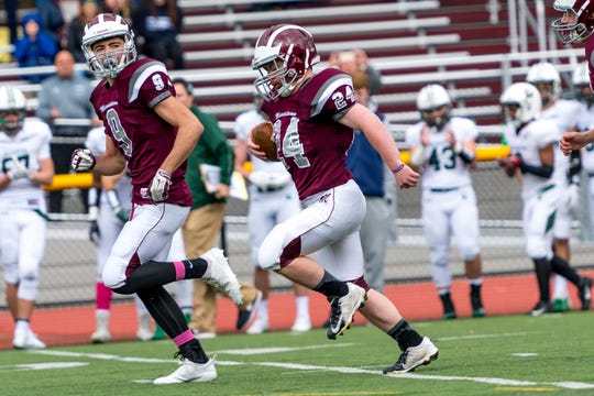 Kevin Hasenbein, a Morristown senior who has Down syndrome, scored a touchdown against Delbarton in 2018. Senior Joe Della Perruti guides him on an 80-yard run.