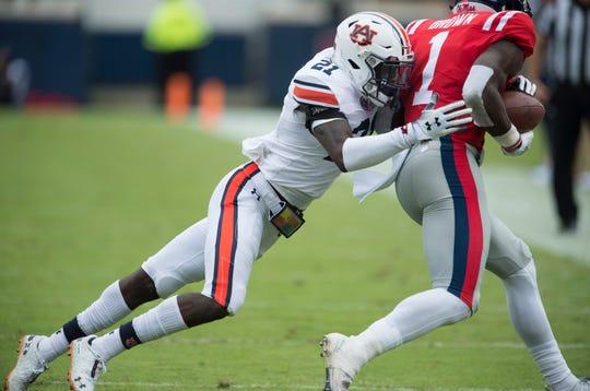 Auburn's Smoke Monday (21) tackles Ole Miss' A.J. Brown (1) at Vaught-Hemingway Stadium in Oxford, Miss., on Saturday, Oct. 20, 2018. Auburn defeated Ole Miss 31-16.