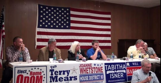 Joanne Whetstone, second from left,  speaks at a campaign event in Rutledge, Alabama.