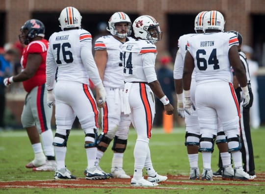 Auburn's Malik Willis (14) lines up to take a snap against Ole Miss at Vaught-Hemingway Stadium in Oxford, Miss., on Saturday, Oct. 20, 2018. Auburn defeated Ole Miss 31-16.