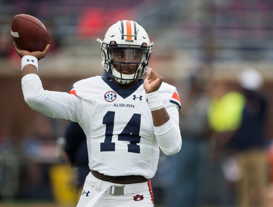 Auburn's Malik Willis (14) warms up before his team takes on Ole Miss at Vaught-Hemingway Stadium in Oxford, Miss., on Saturday, Oct. 20, 2018. Auburn defeated Ole Miss 31-16.