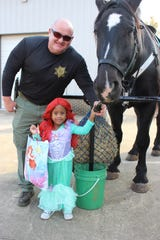 Londyn Slaughter as Ariel flashes a princess smile with Rutherford County Sheriff's Cpl. Jon Levi.