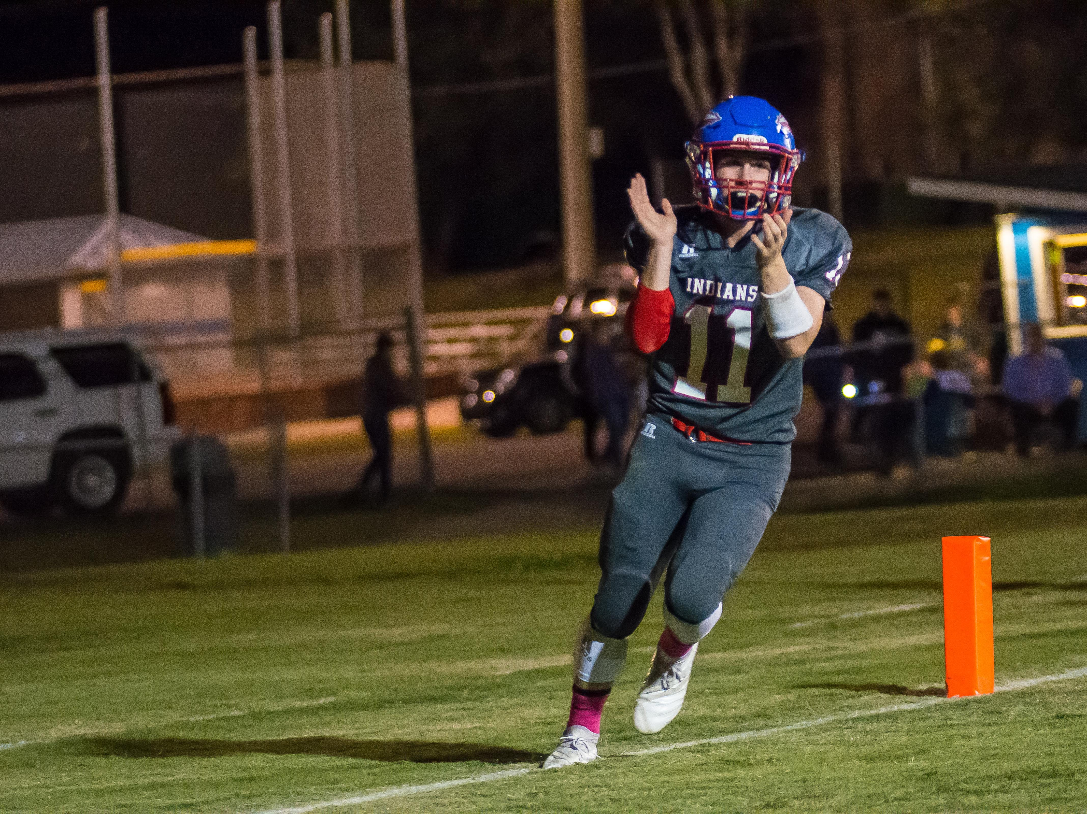 Harpeth's Luke Gossett celebrates in the end zone after one of his five touchdowns against Fayetteville.