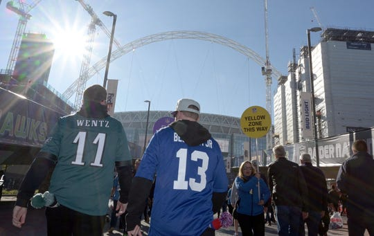 Fans wearing the jerseys of Philadelphia Eagles quarterback Carson Wentz (11) and New York Giants receiver Odell Beckham Jr. (13) arrive to the game Sunday.