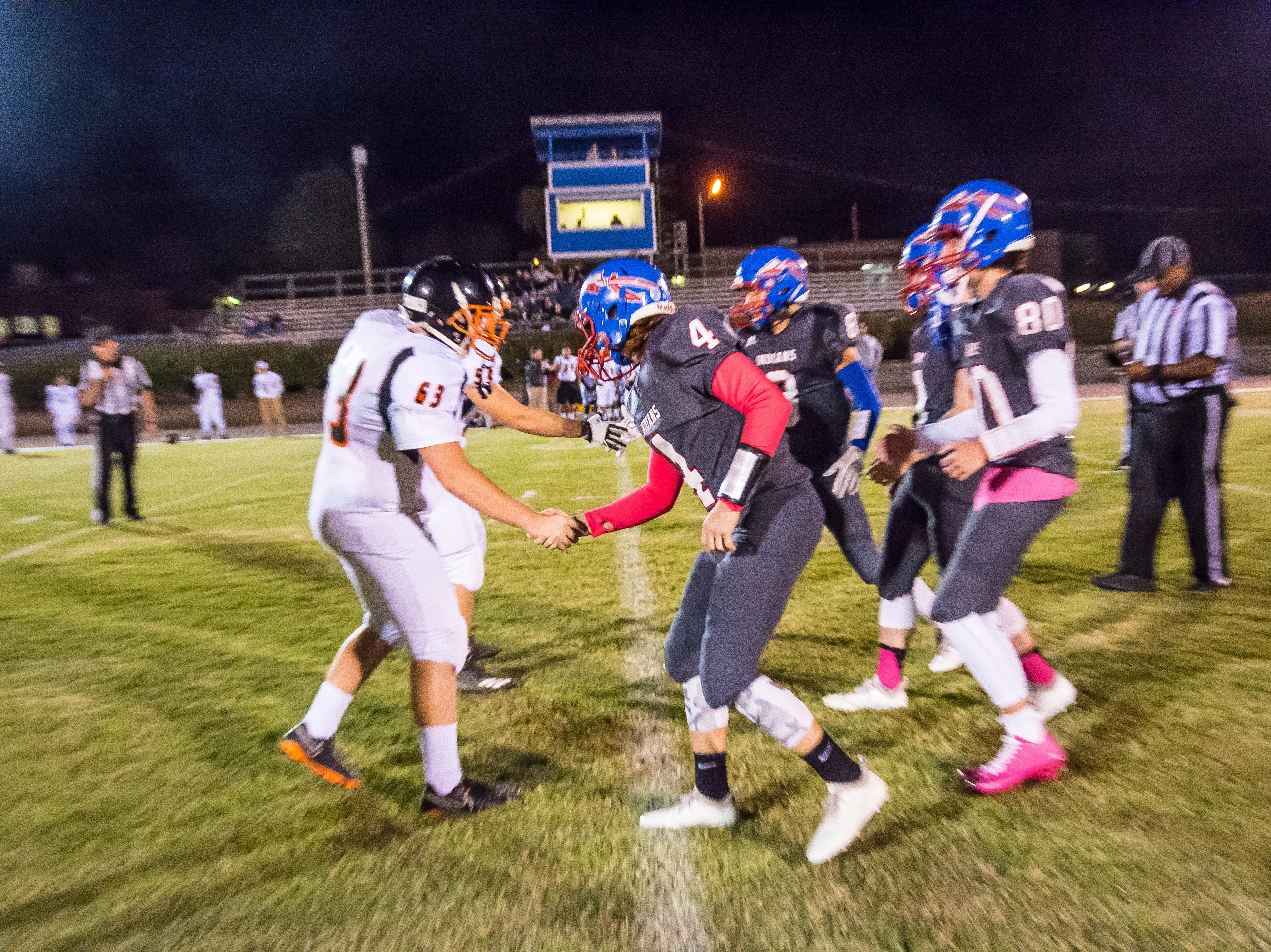 Fayetteville captains (left) and Harpeth captains shake hands before their game.