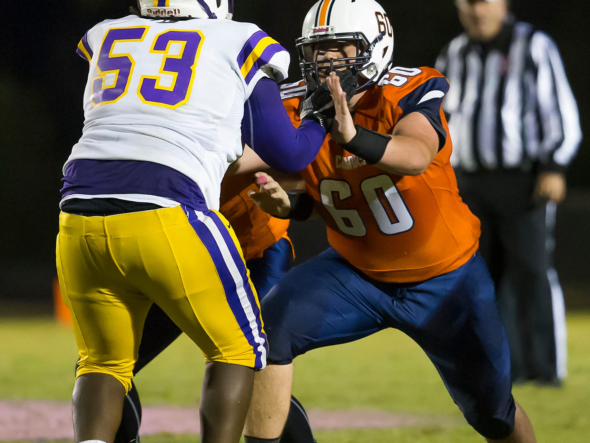 Dickson County's Noah Chapdelaine goes against a Lawrence County lineman.