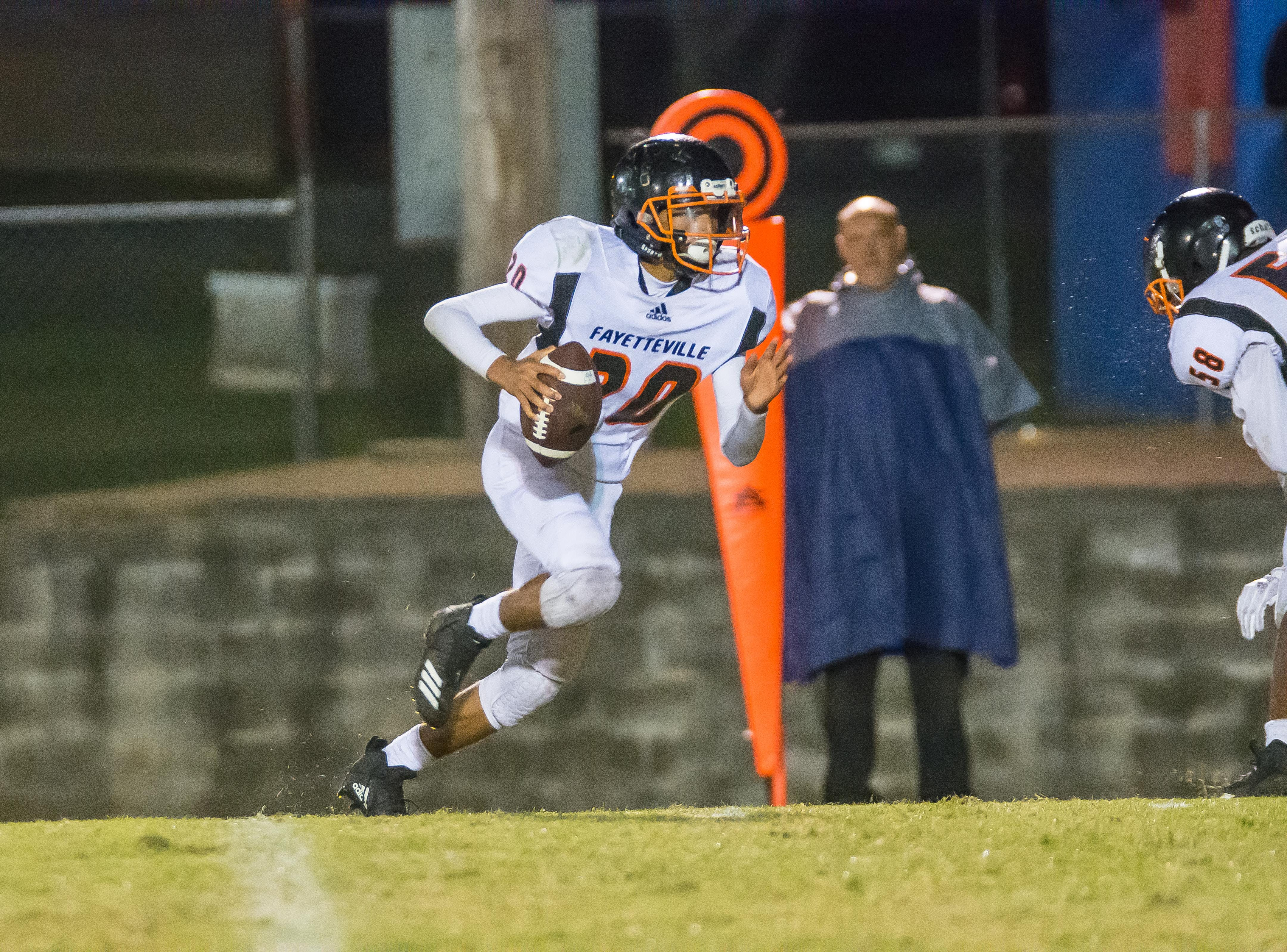 Fayetteville sophomore Zayshon Pullen runs the football against Harpeth.