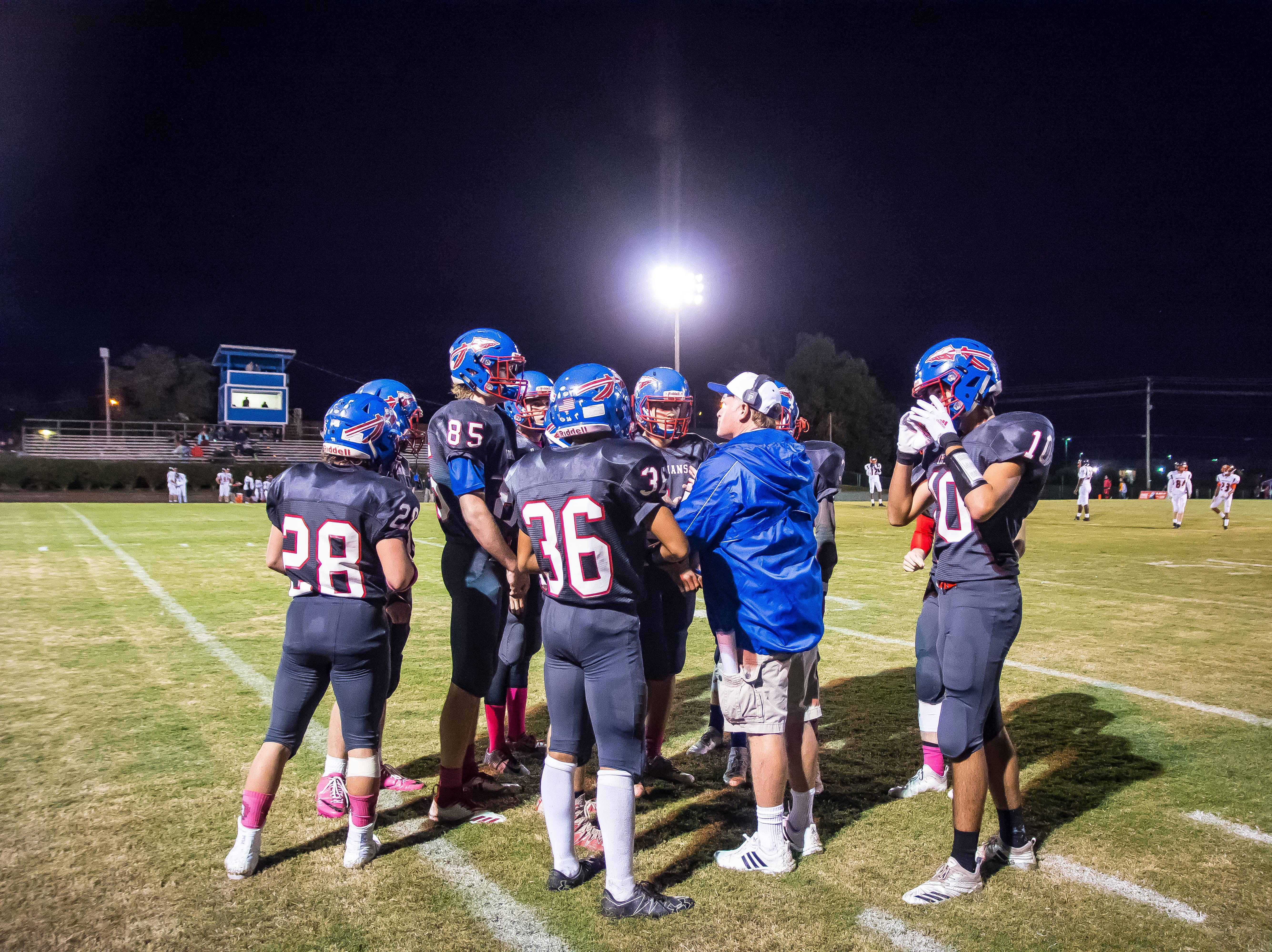 Harpeth coach Doug Loope giving his guys some last minute instructions.