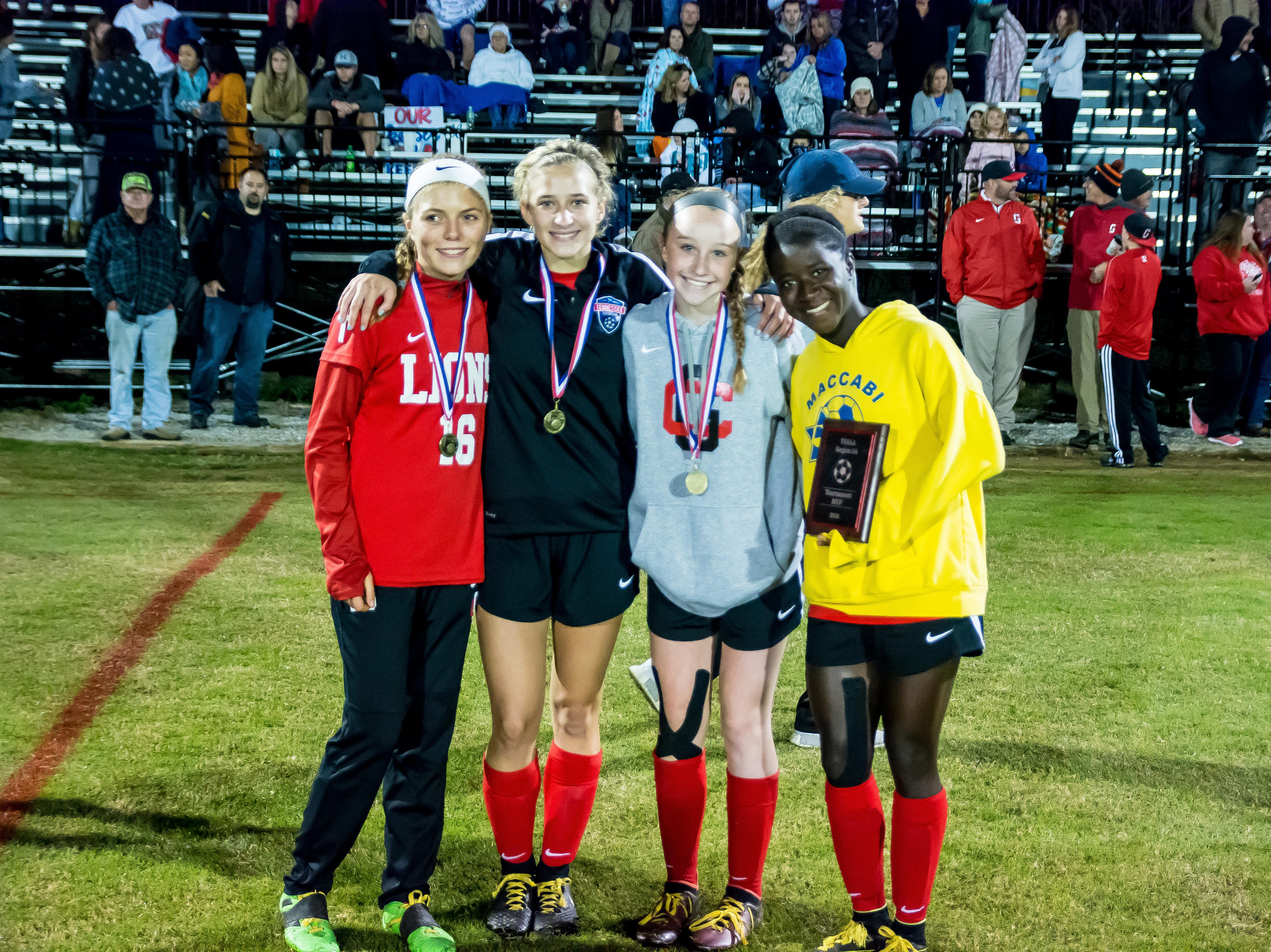 Grace Christian's region tournament award recipients included Hannah Stone, Abby White, Caroline Briley and tournament MVP Gabby Jones.