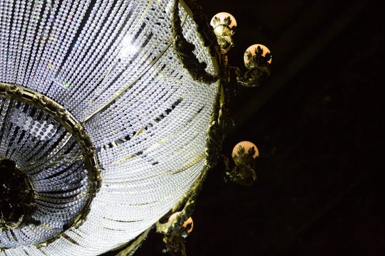 The chandelier weighs 1 ton and contains more than 6,000 beads.