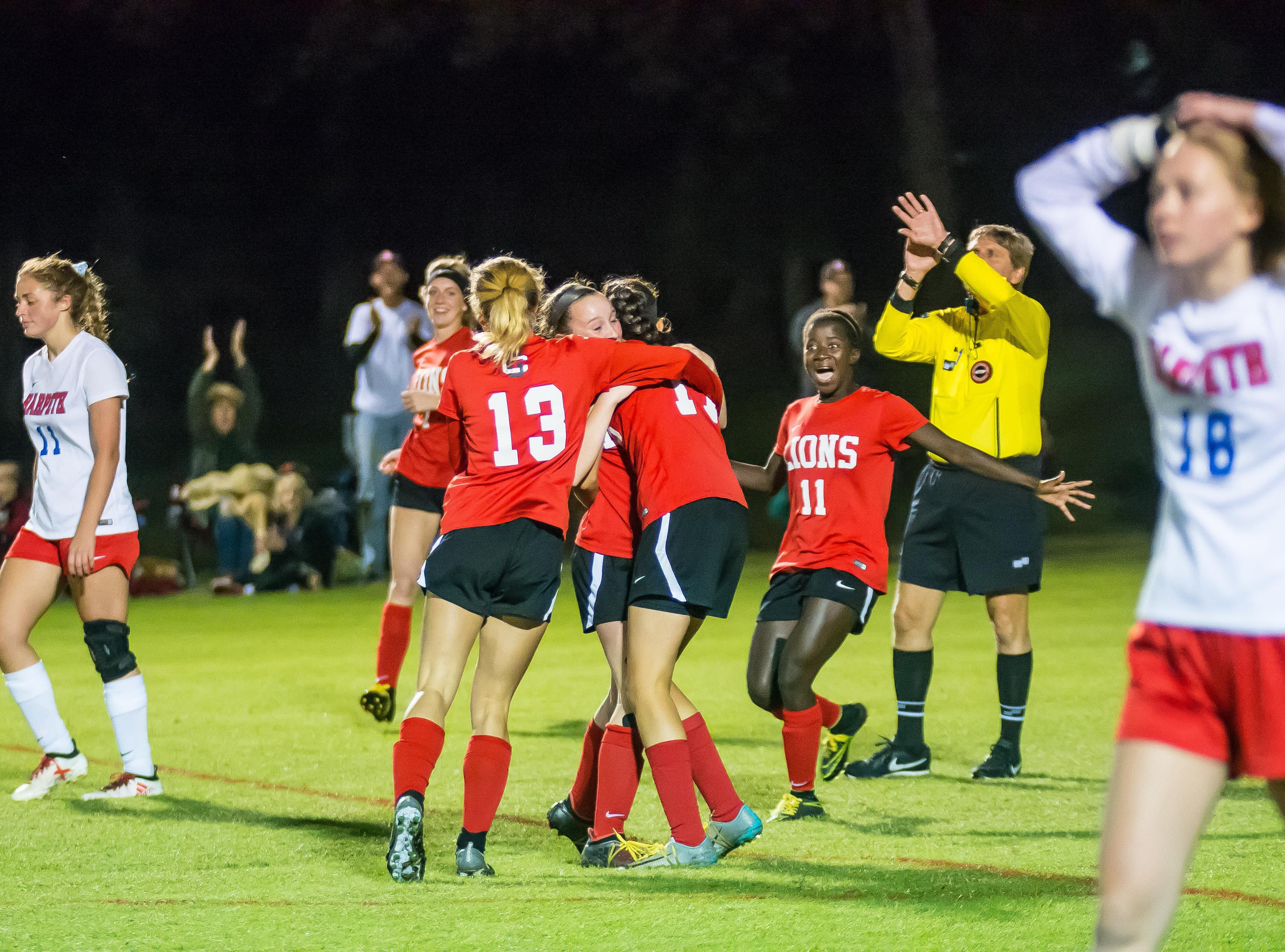 Grace Christian celebrates a goal.