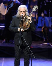 "Ricky Skaggs holds a 1923 Gibson F5 Lloyd Loar mandolin that belonged to Bill Monroe and has been on display at the Country Music Hall of Fame and Museum after using it to perform ""Will the Circle Be Unbroken"" during the 2018 Medallion Ceremony at the CMA Theater in the Country Music Hall of Fame on Oct. 21, 2018."
