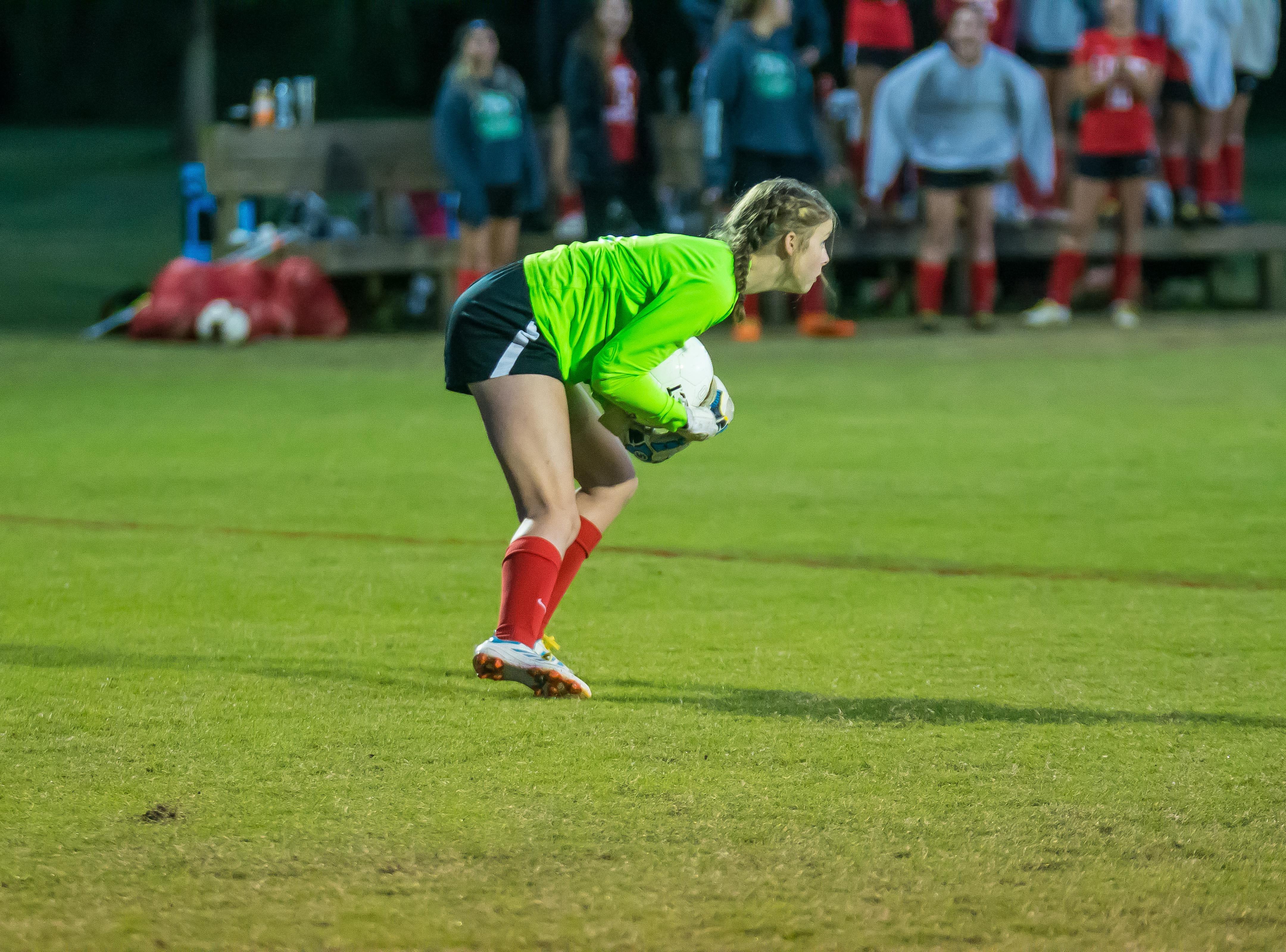 Grace Christian's Carlie Mason stops a shot.