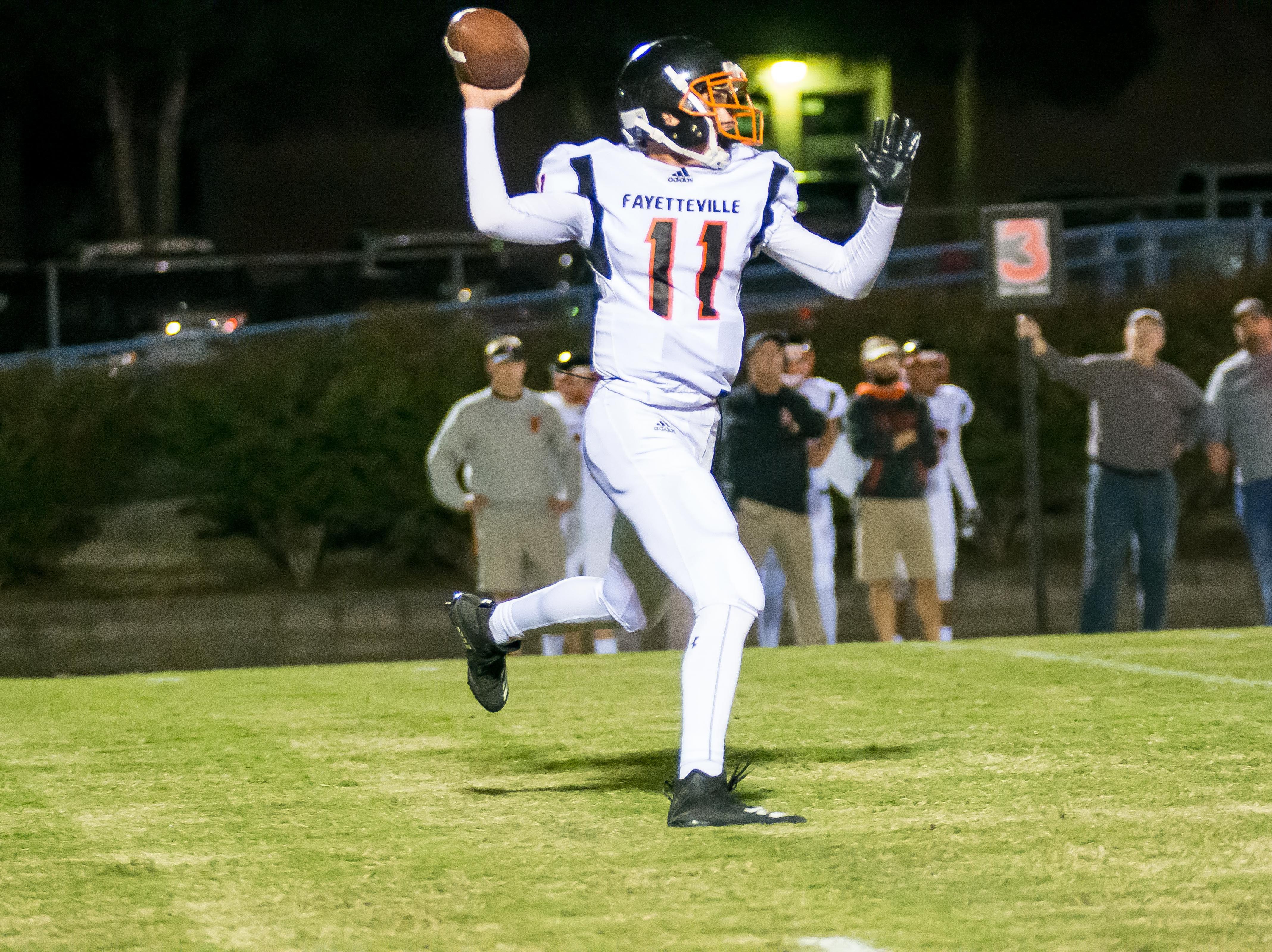 Fayetteville quarterback Levi Sloan throws a pass.