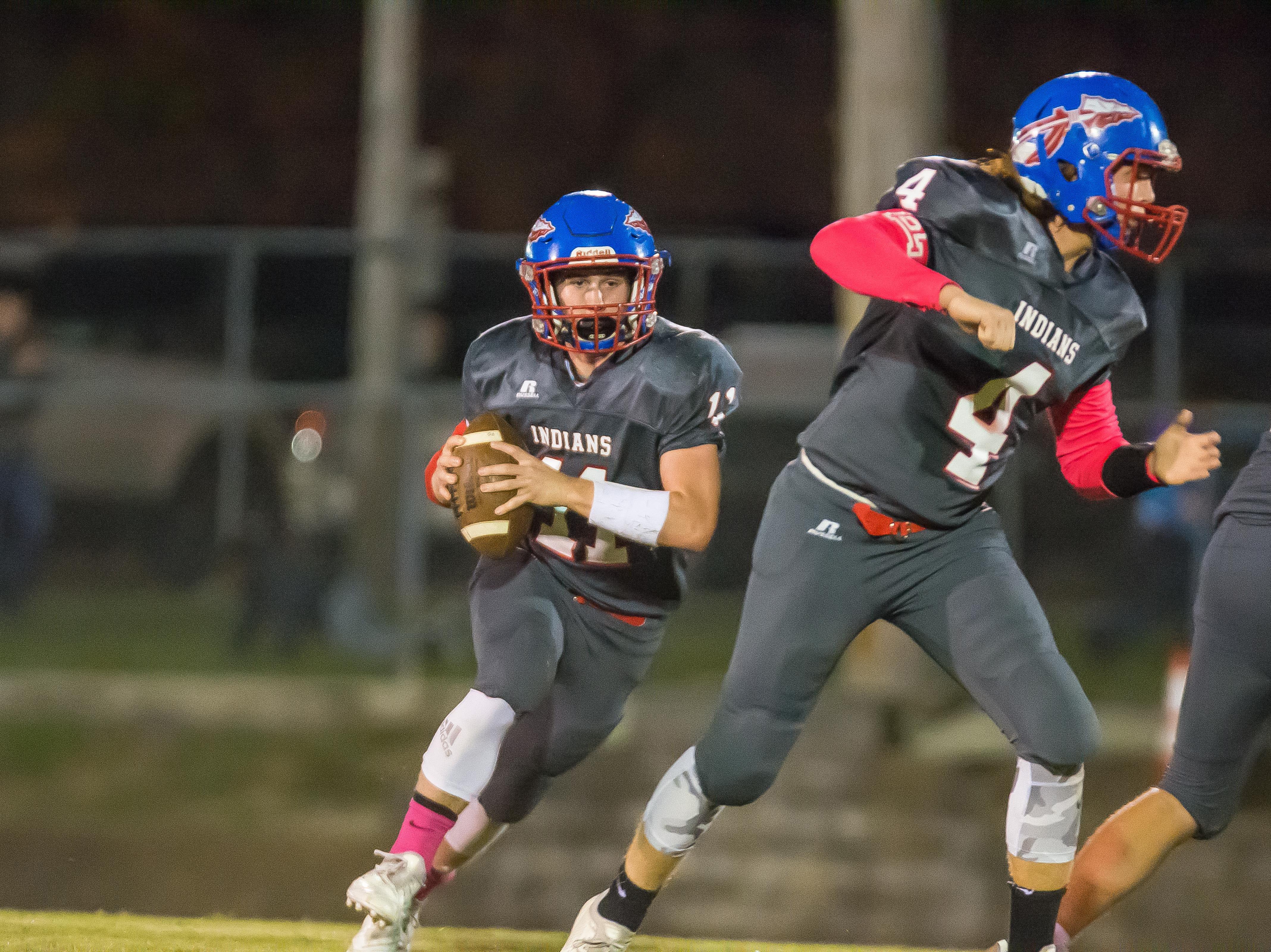 Harpeth's Luke Gossett runs the football against Fayetteville.