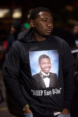 Juan Adams, father of Brandon Adams, is seen during a vigil Sunday, Oct. 21, 2018, held to remember Brandon who was shot and killed in the parking lot of McGavock High School, in Nashville, Tenn.