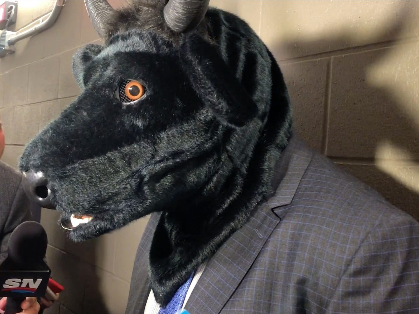 Predators coach Peter Laviolette wore a bull mask after the team's victory over the Edmonton Oilers on Oct. 20, 2018