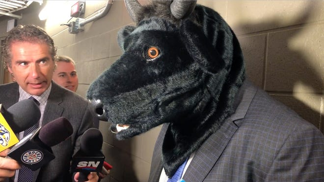 Predators coach Peter Laviolette wore a bull mask after the team's victory over the Oilers on Saturday.
