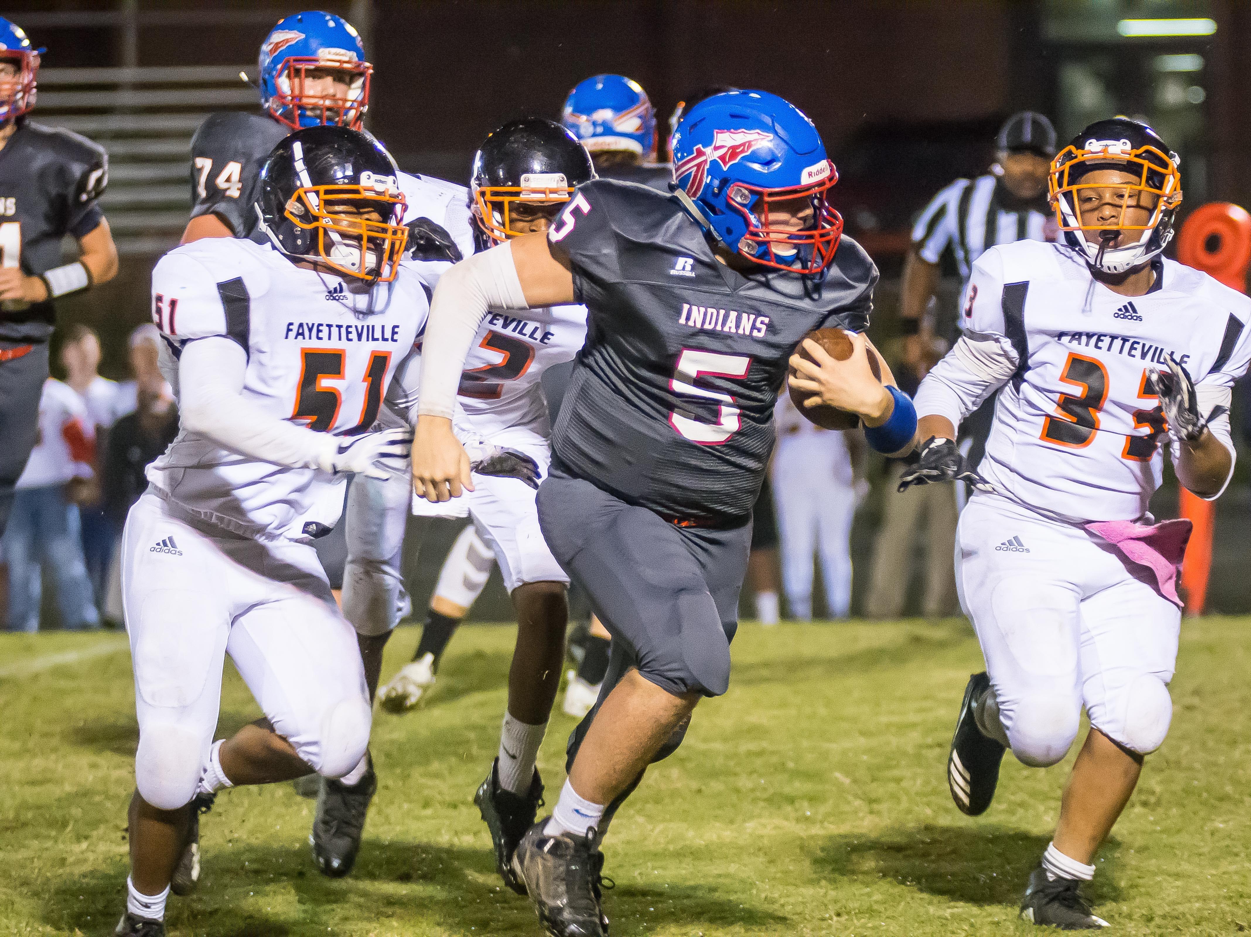 Harpeth quarterback Thomas Sloan on the run.