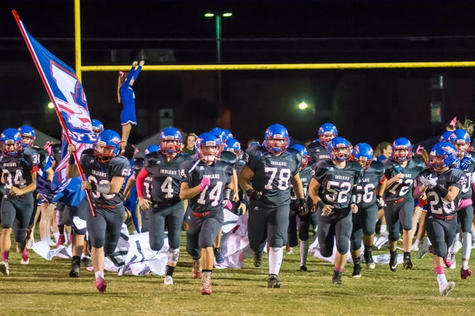 Harpeth football takes the field before its game with Fayetteville.