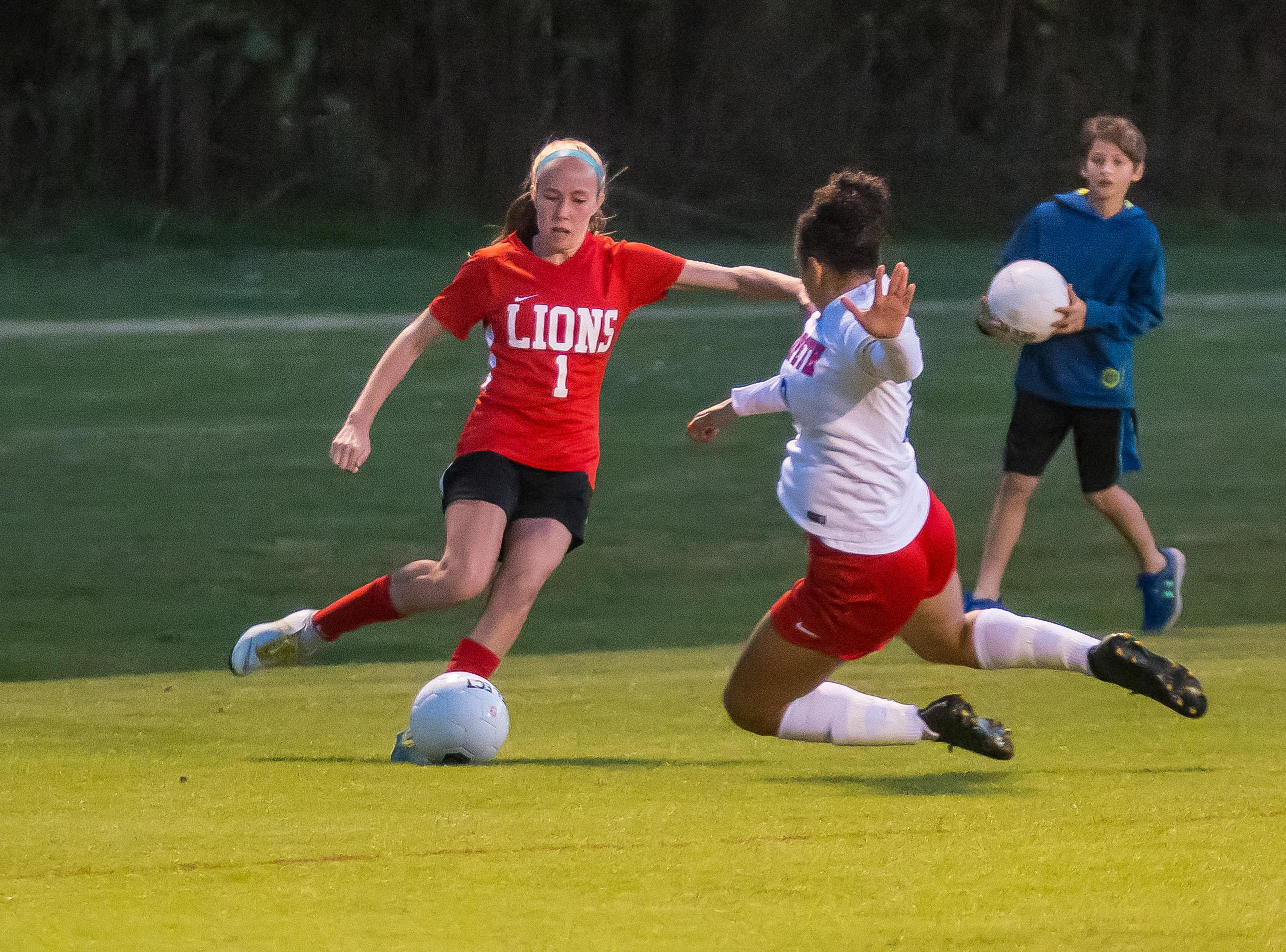 Grace Christian freshman Anna Cate Beachum and Harpeth senior Alessia Powers battle for the ball.