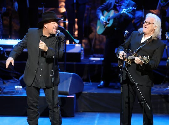 "Garth Brooks joins Ricky Skaggs to perform ""Will the Circle Be Unbroken"" during the 2018 Medallion Ceremony at the CMA Theater in the Country Music Hall of Fame and Museum on Sunday, Oct. 21, 2018."